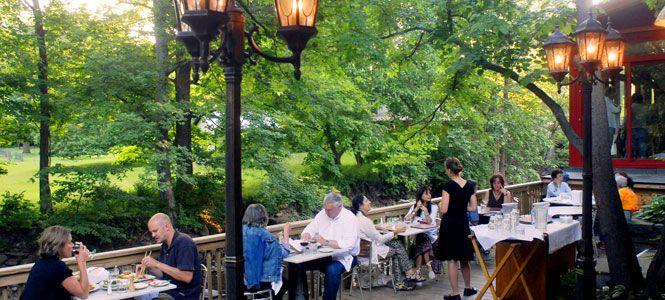 Streamside patio dining at The Bear Cafe, 295 Tinker Street