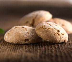 Almond cookies on a dark wooden background