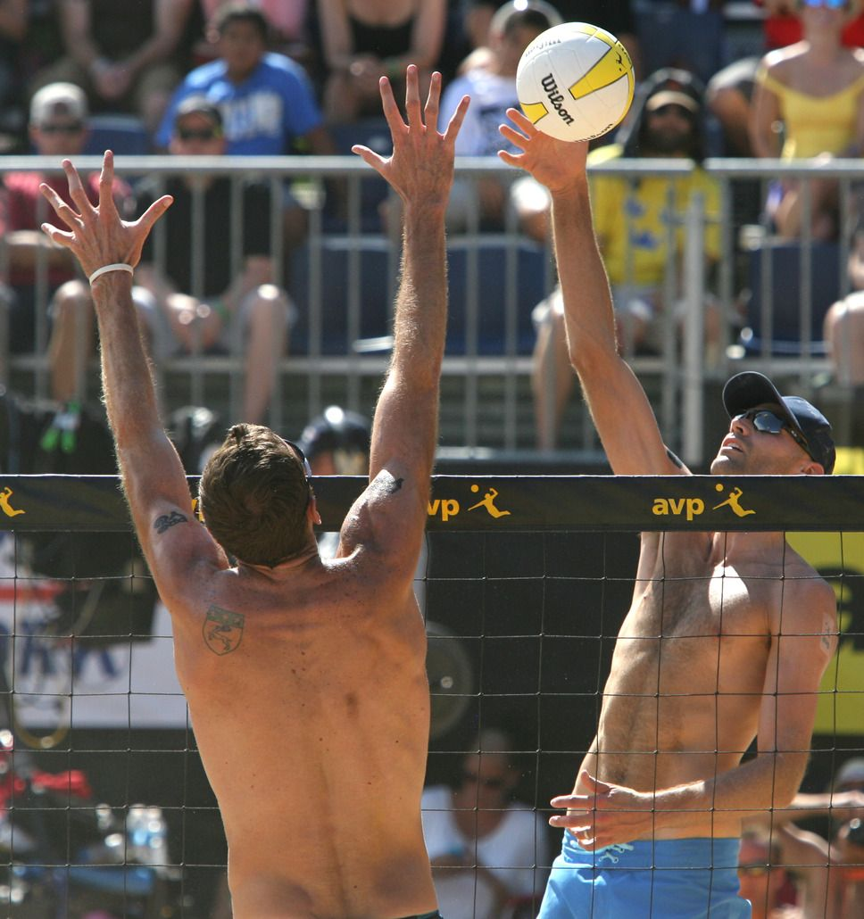 Rick Egan The Salt Lake Tribune Phil Dalhausser Hits The Ball As Ryan Doherty Defends In The M Avp Volleyball Volleyball Tournaments Beach Volleyball