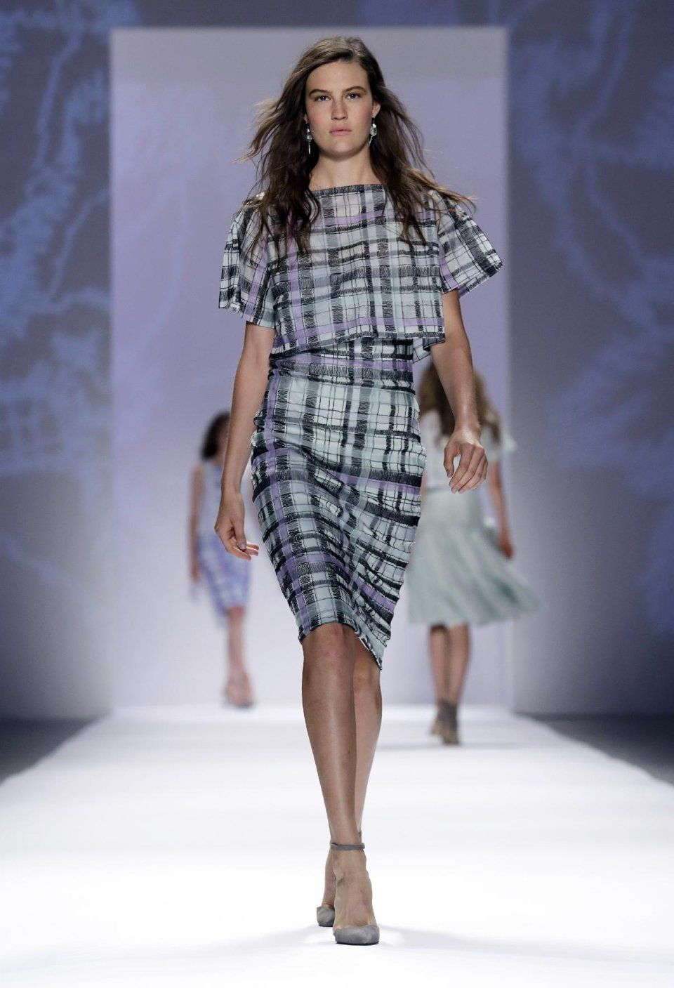 The Tadashi Shoji Spring 2014 collection is modeled during Fashion Week in New York, Thursday, Sept. 5, 2013. (AP Photo/Richard Drew)