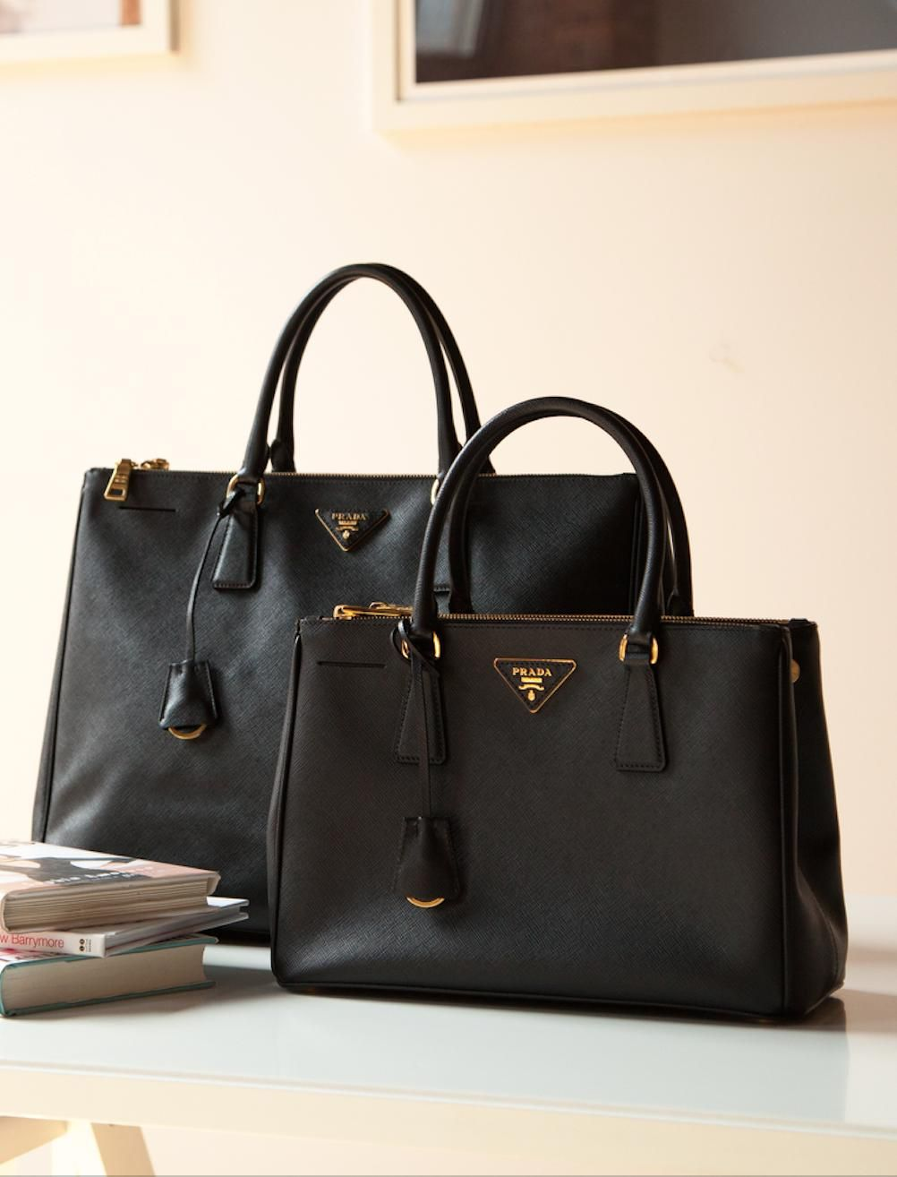 Large and small black Prada tote in saffiano leather.  67e4bfd0dcb5e