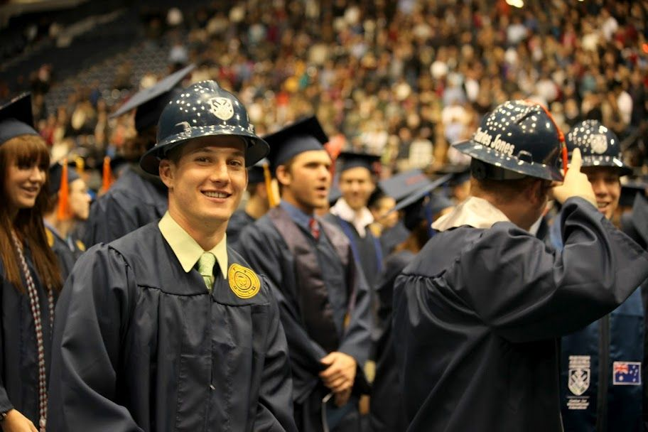 5b661e30d91 Construction management graduates don hard hats rather than mortar boards  at the fall 2011 commencement ceremony.