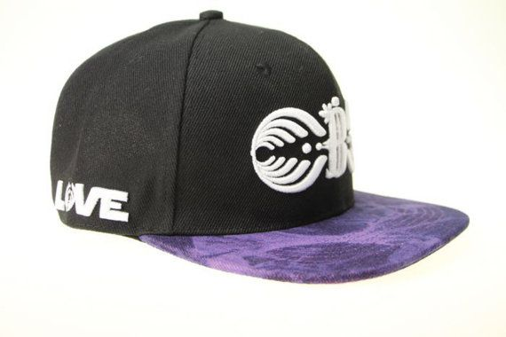 1e5a62262aa Custom Bassnectar Snapback Fabric is cut at different angles making each  brim unique No two hats are the same One size fits all Limited quantity  available