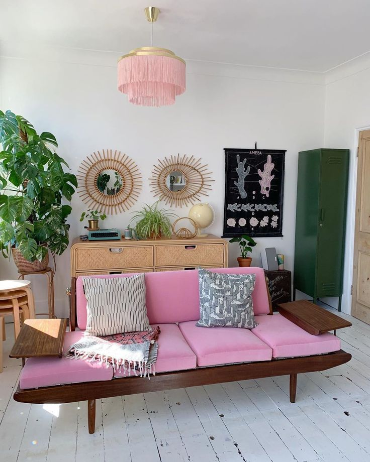 Pink vintage sofa with rattan mirrors and chest of drawers... 70s meets mid cent