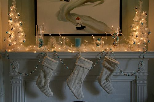 dimmed christmas lights decoration on mantel