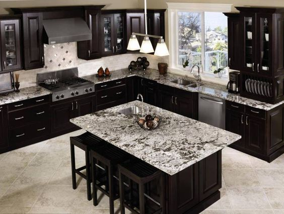 Aspen White Granite Provides A Timeless Kitchen Design Kitchen Cabinet Design Kitchen Cabinet Inspiration Black Kitchen Cabinets
