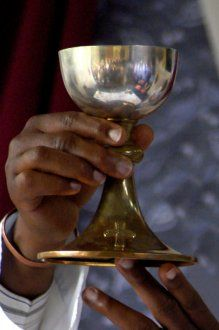 Chalice being elevated at Consecration.