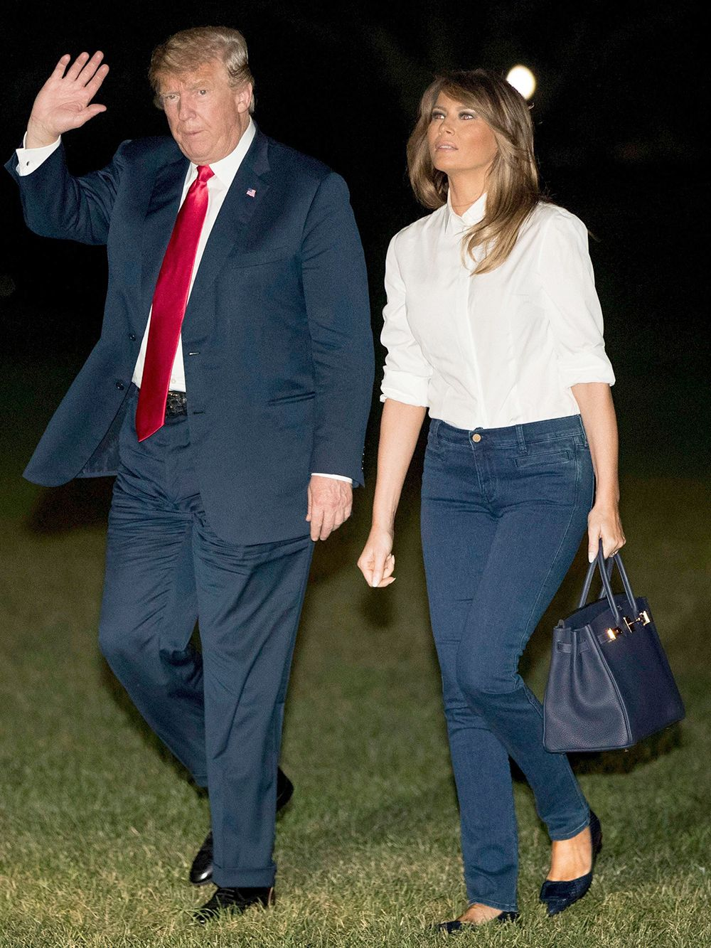 8e29fe9b57 Melania Trump returns to the US on July 16 wearing jeans and flats after  meeting with NATO and Putin.