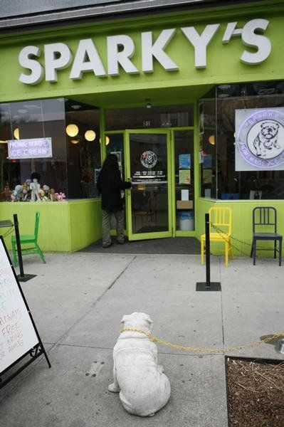 Sparky keeps an eye on things outside of Sparky\'s Homemade Ice Cream ...