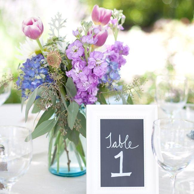 Blue Vases Held Small Arrangements Of Tulips, Snapdragons
