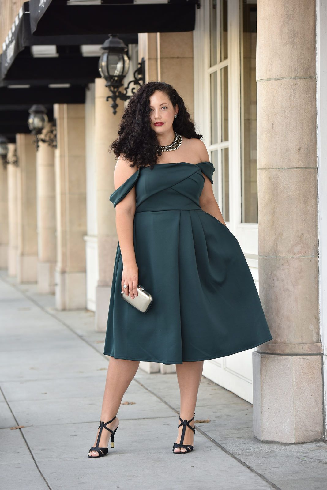 72ebdc6ccdc9 Girl With Curves blogger Tanesha Awasthi wears an emerald off-shoulder dress