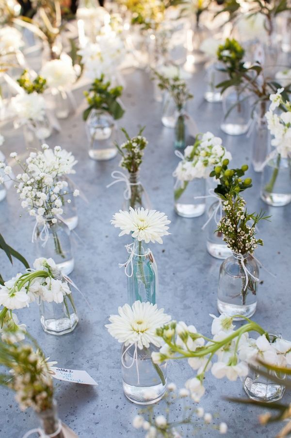 floral bud vases as escort cards, photo by Courtney Dox Photography http://ruffledblog.com/romantic-southern-wedding-in-south-carolina #weddingideas #seatingcharts #escortcards