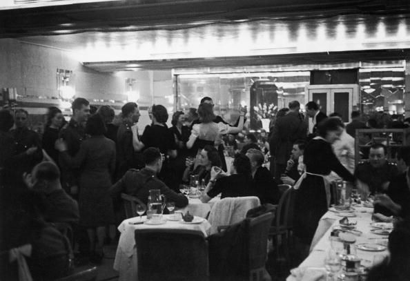 Soldiers and civilians having dinner and dancing in a night club in London during World War II, 1st November 1941. Original Publication: Picture Post - PP 917 - The Night Life of London - pub. 1941. (Photo by Bert Hardy/Picture Post/Getty Images)