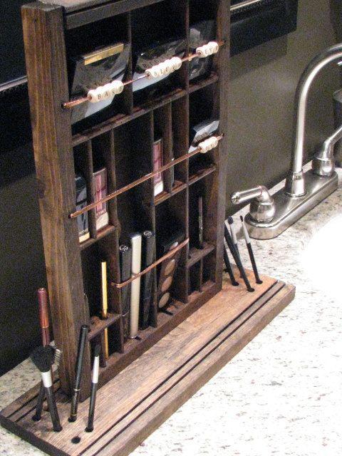 Mom: knick knack shelf (or drawer) nailed to desk top pen holder