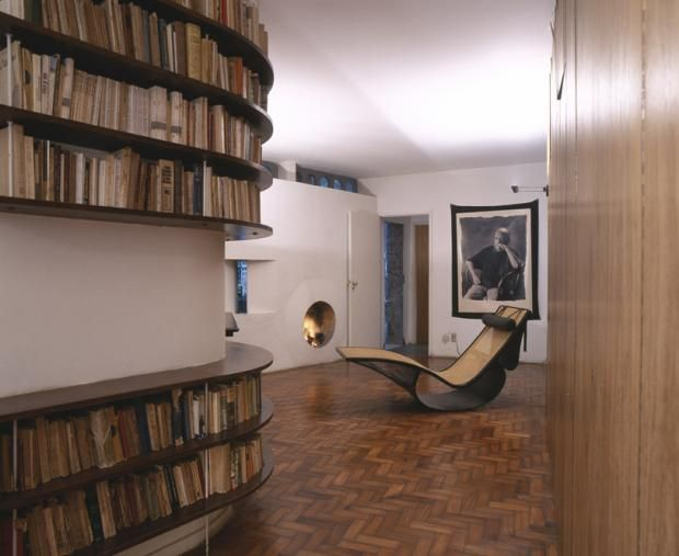 oscar niemeyer's casa das canoas, parquet floor, rocking chair, bookshelves