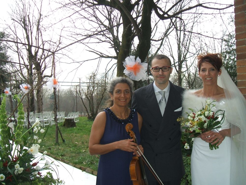 Bride And Groom With Wedding Musician After Their Civil Ceremony In The Garden Of A