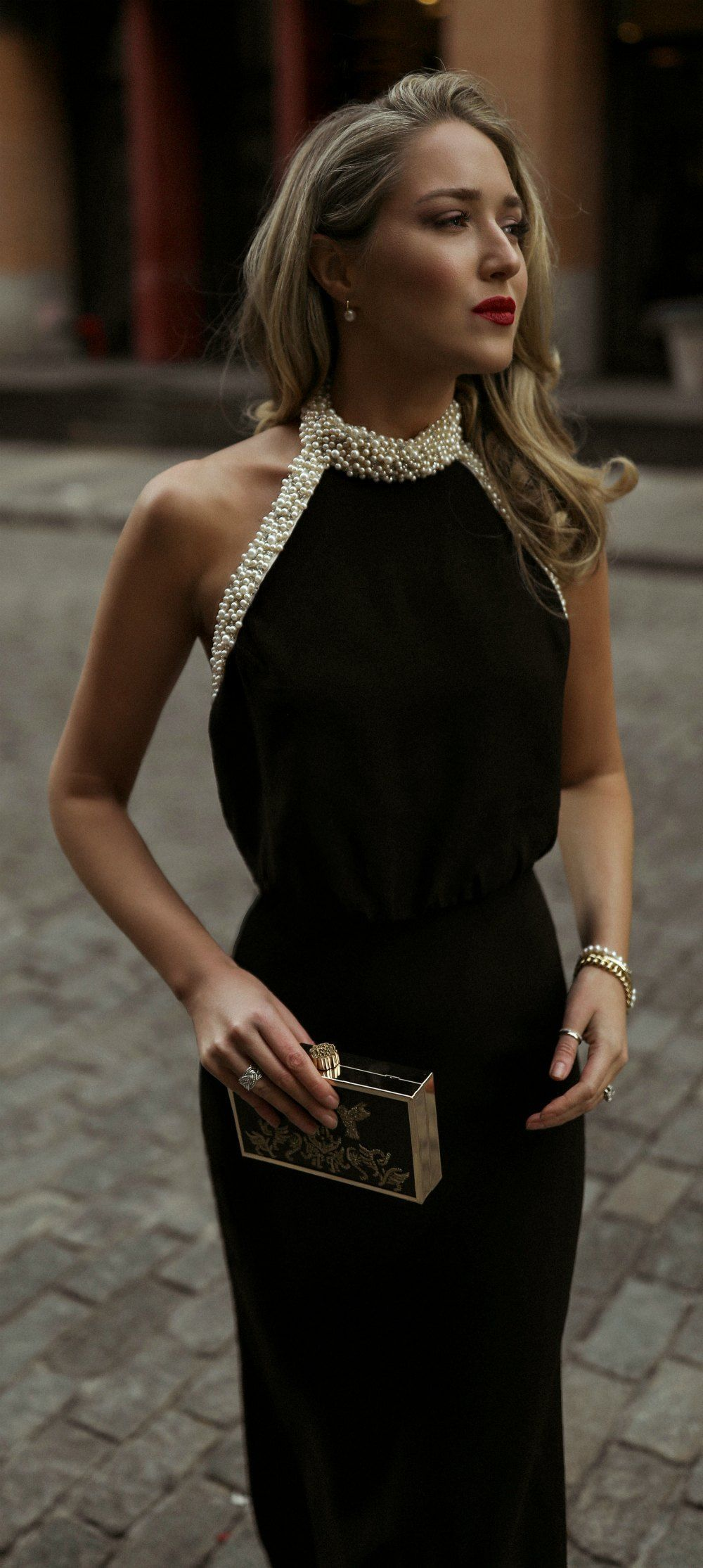 Day 17 Corporate Charity Black Backless Gown With A Glamorous Pearl Encrusted Halter Neck Black Gold Clutch Pu Black Dress Gold And Black Dress Fashion [ 2229 x 1000 Pixel ]
