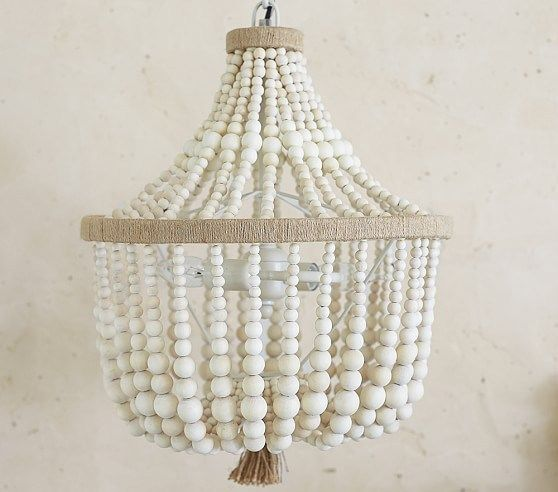 See How I Transformed A Plain Budget Friendly Ikea Chandelier Into A Farmhouse Style Wood Bead Chand Wood Bead Chandelier Dahlia Chandelier Nursery Chandelier