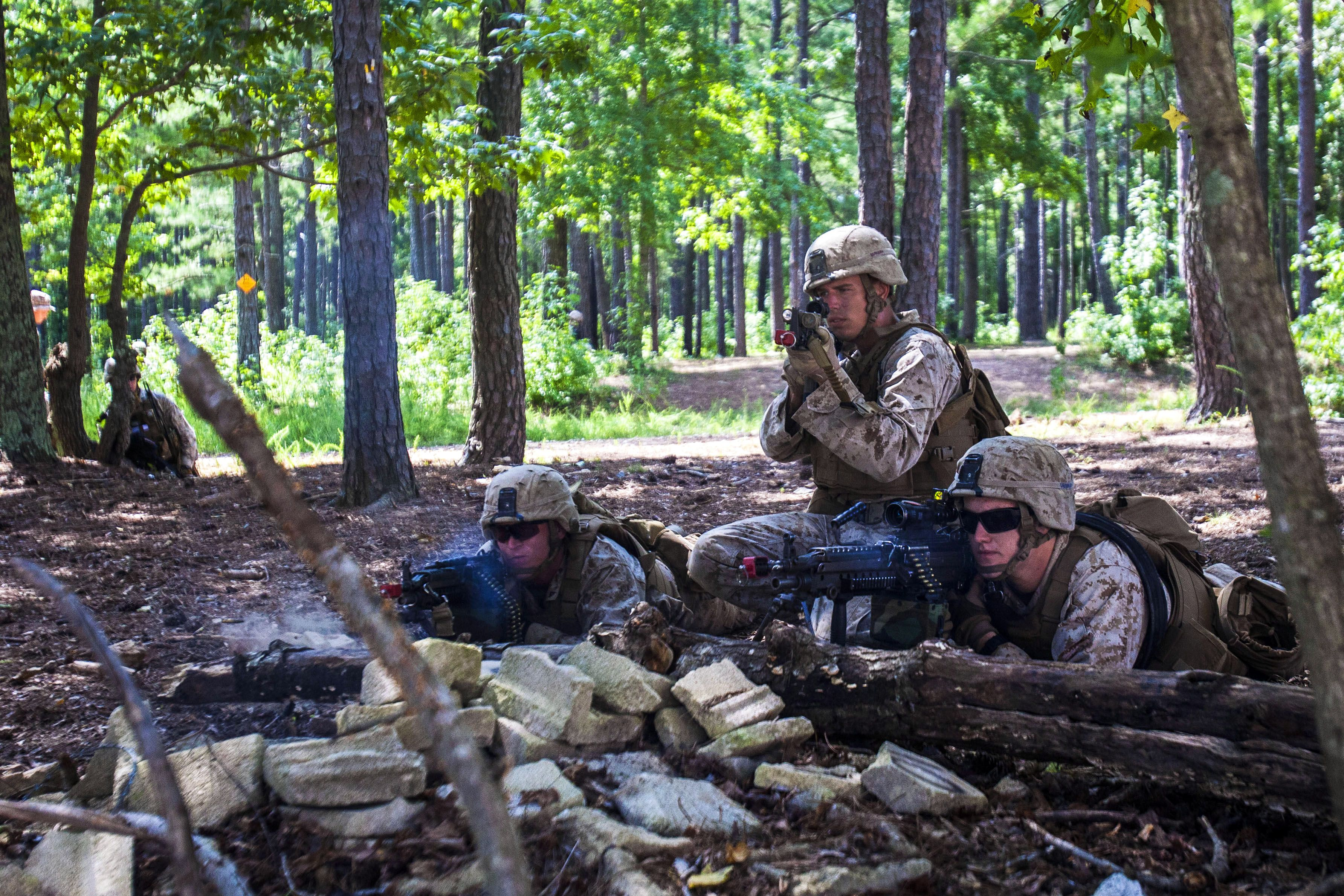 Marines provide cover fire as Marines carry a simulated casualty to medical aid while conducting a platoon-sized raid on a simulated town during urban tactics training on Fort Pickett, Va., Aug. 31, 2013. U.S. Marine Corps photo by Sgt. Austin Hazard