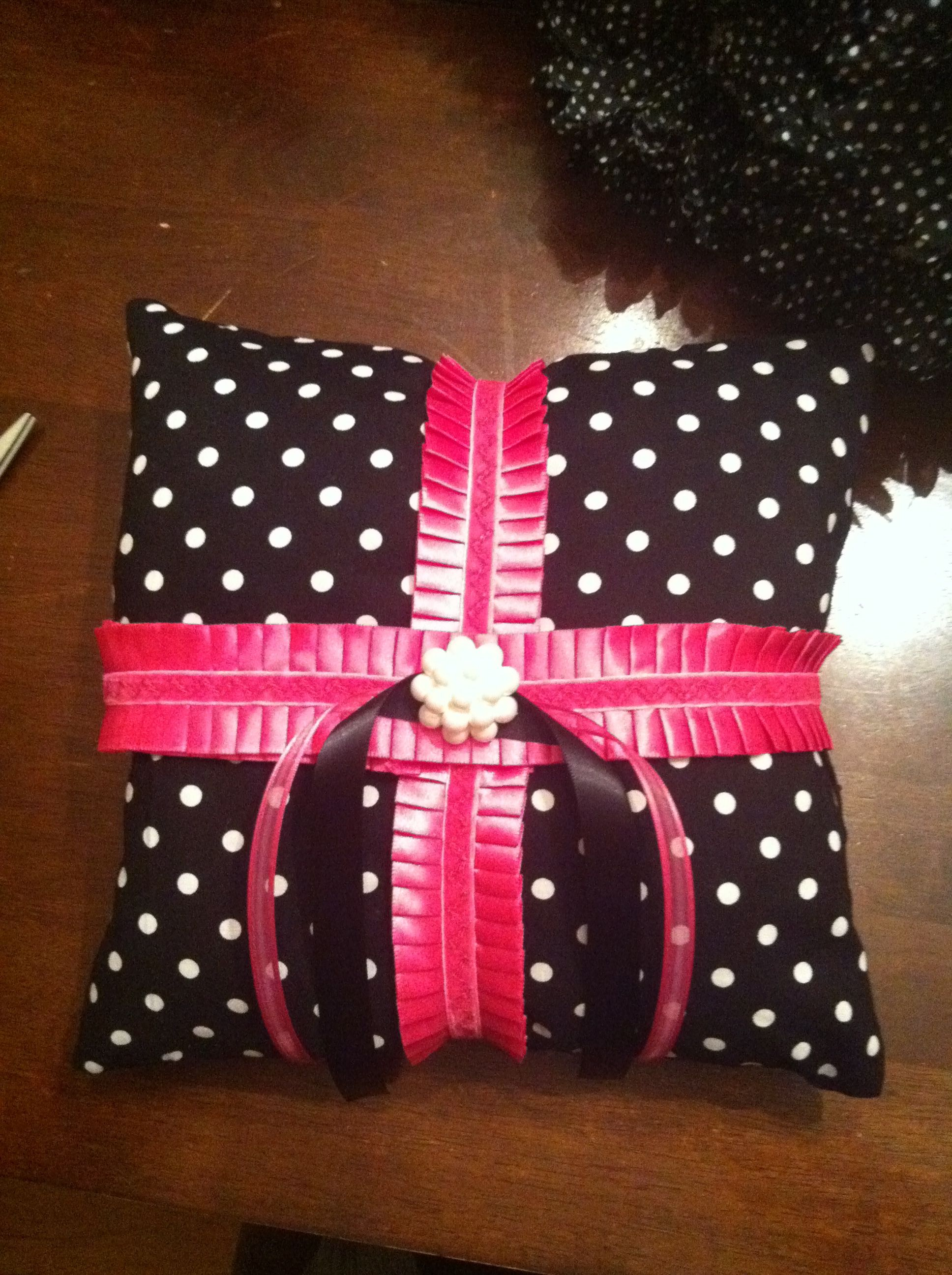 Ring bearer pillow with red ribbon of course wedding wonderland