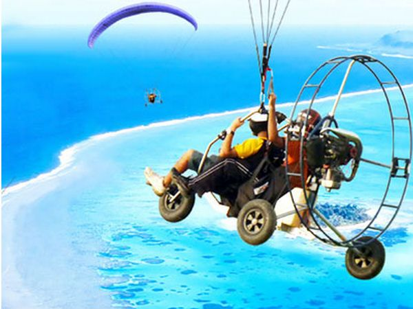 Buy unique travel experiences online, such as Paramotoring