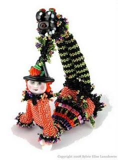 A stunning mix of handmade lampwork beads & seed bead weaving: Whimsy Girls by Sylvie Elise Lansdowne - How adorable is this little lady in her halloween costume!