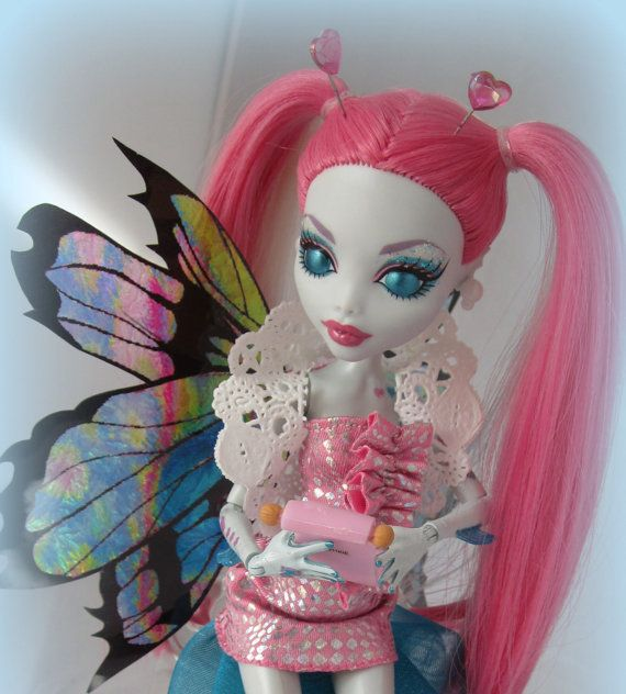 love bug, pink hair, big blue eyes, there is something to love about this doll.