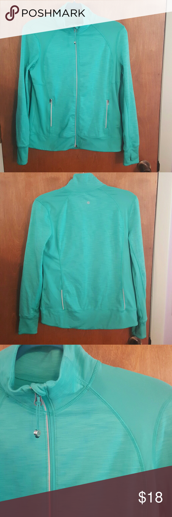 Athletic Zip up Turquoise athletic Zip up by Tangerine. Worn once washed once in cold and hung dry. No flaws just trying to downsize my closet. Tangerine  Tops Sweatshirts & Hoodies
