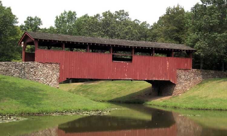 Burns Park Covered Bridge  Built:1972  Truss: Stringer  Photos by Francis Romer (July 2004)  Location:  Over White Oak Bayou in Burns Park off of I-40 at exit 150, then south to Burns Park.  Pulaski Co - AR
