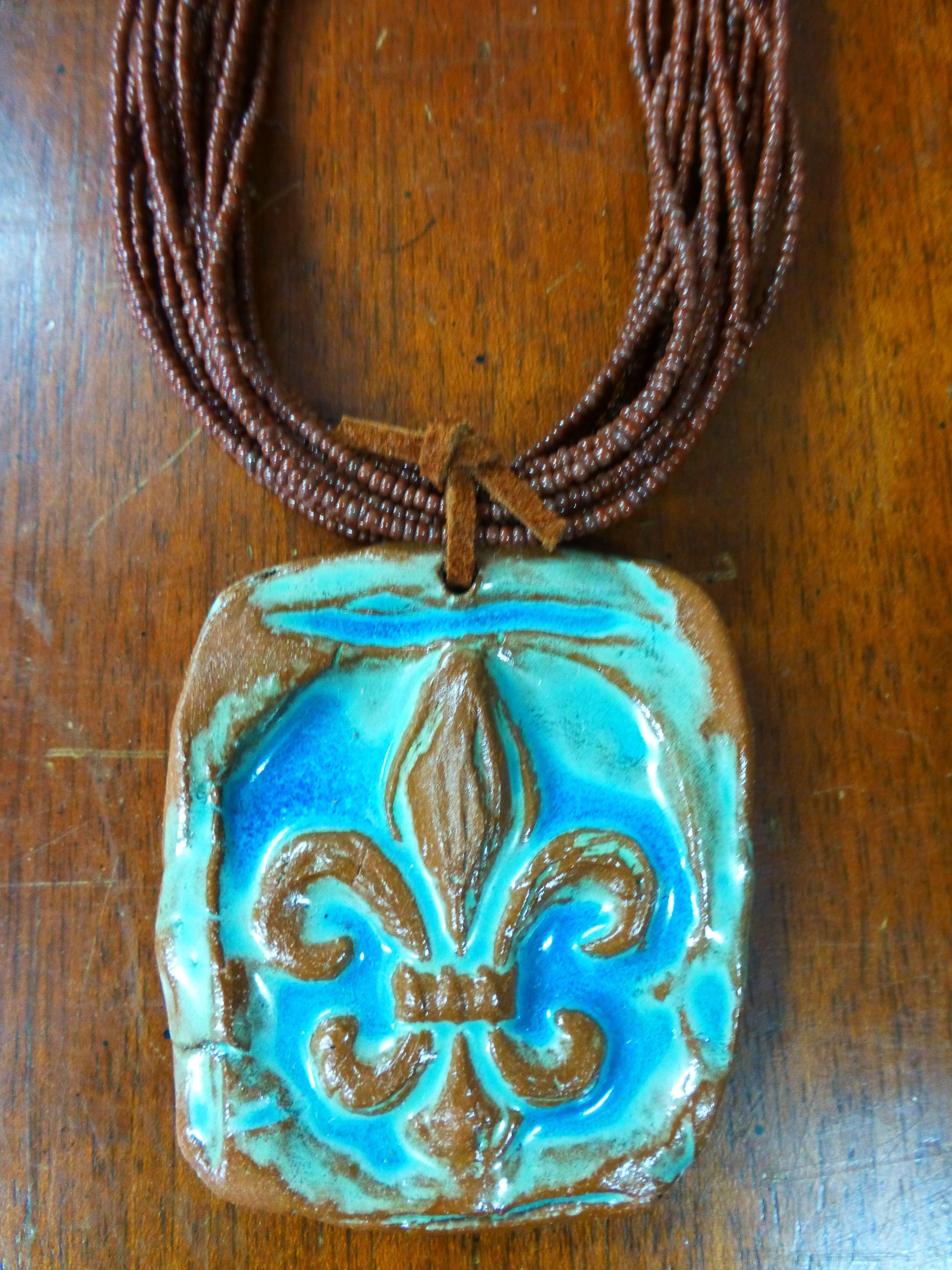 Fleur De Lis Clay Pendant Bead Necklace
