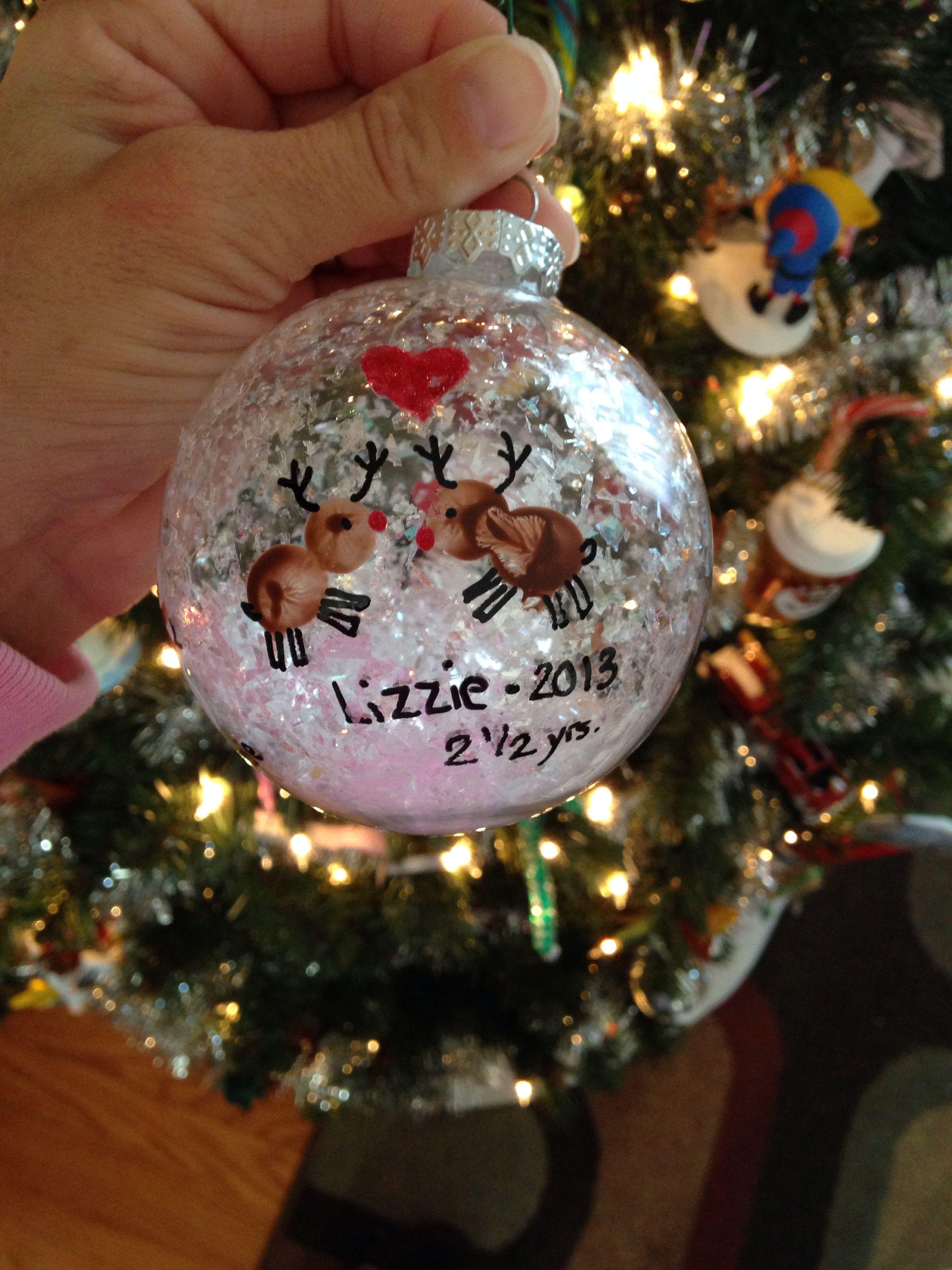 DIY Christmas Ornament for kids we used thumb prints to