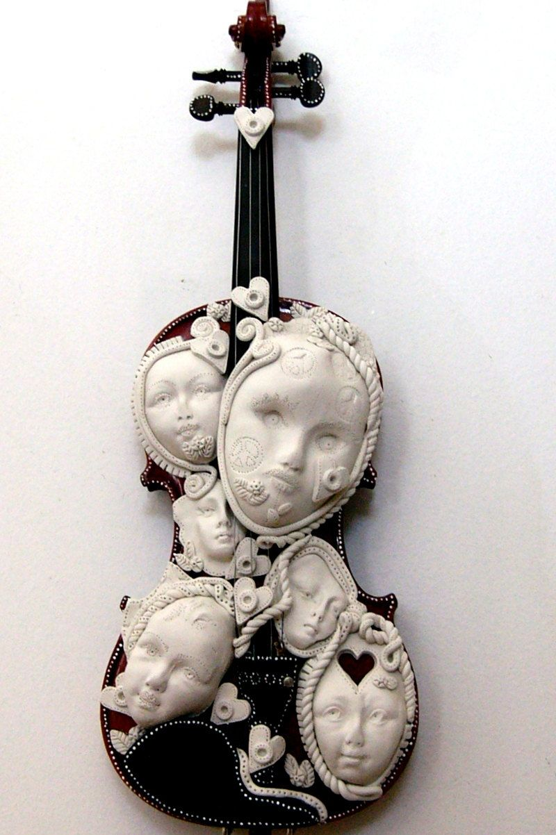 Stop The Violince  recycled found object sculpture violin I Am Published Now. $600.00, via Etsy.
