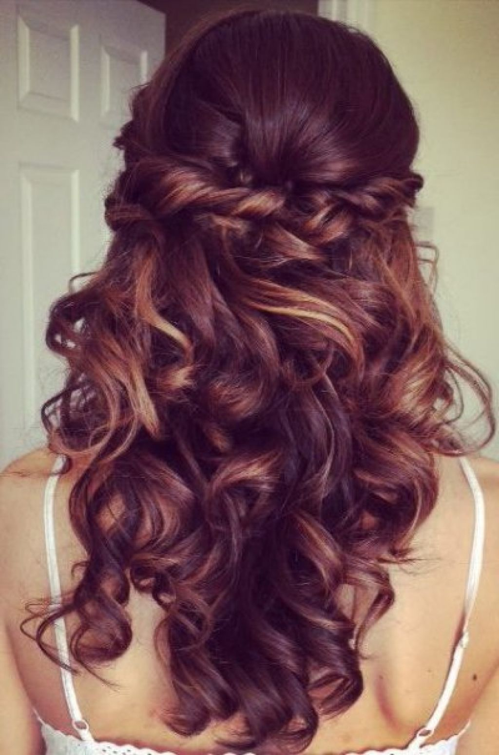 elegant curly half updo prom hairstyle with bouncy long curls
