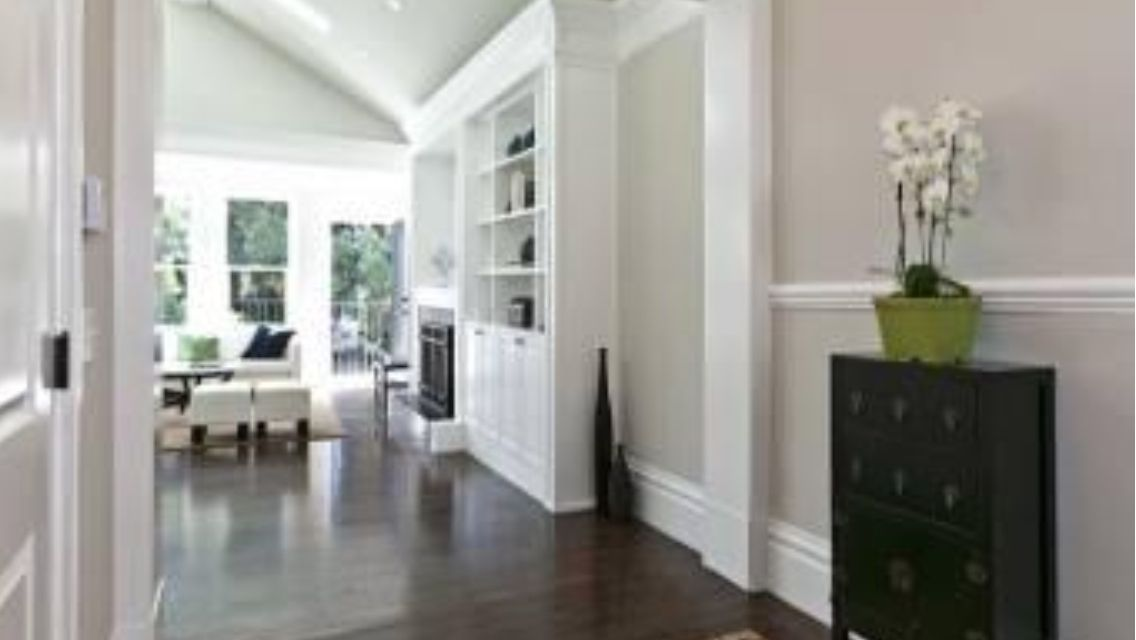 dark wood floor, light grey walls, white trim | home - color