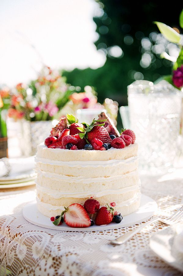 A Naked Vanilla Cake Topped With Figs And Berries By Cake Works - Cake Works Wedding Works