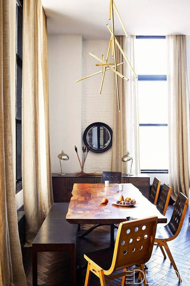 We love the inspired mix and match style of this dining space the