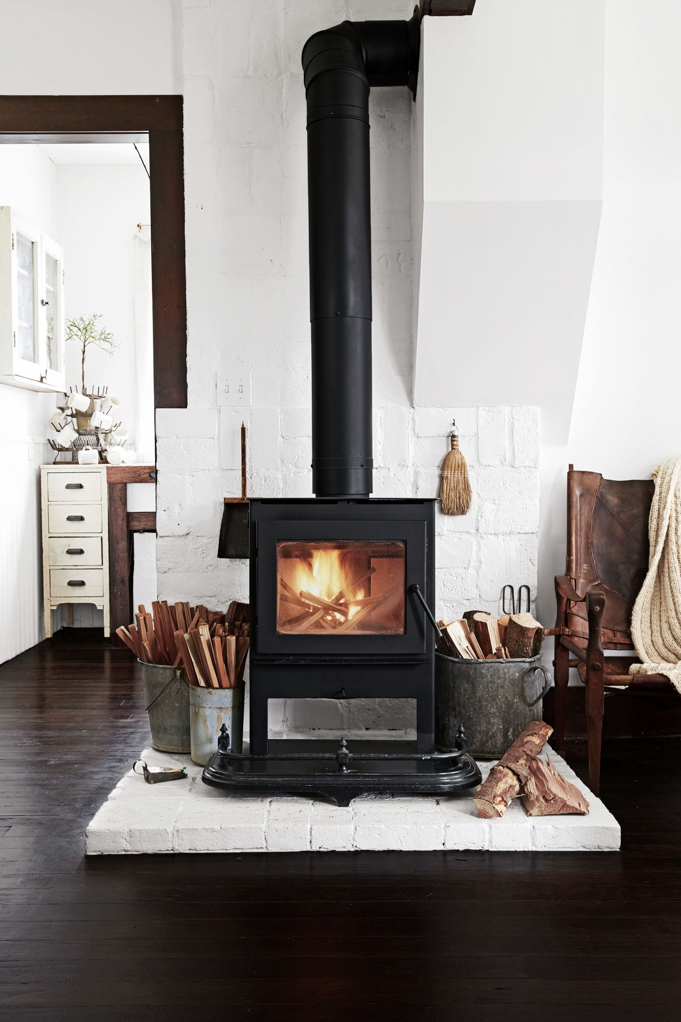 wood burning stove with white brick rustic modern pinterest