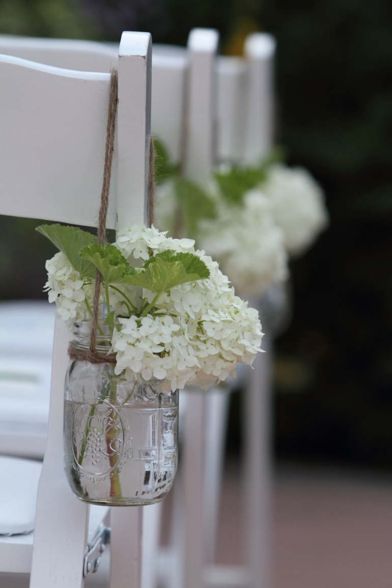 Simple and rustic ceremony chair decor - mason jar with white