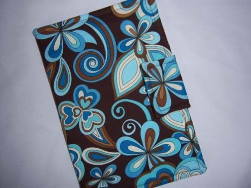 Look what I bought today. $18 Kindle cover I love the pattern and the color.