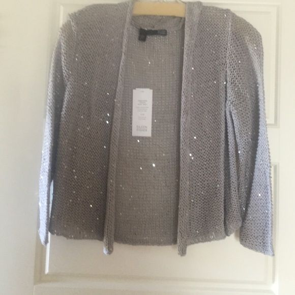 Gray shrug with silver accents. Never worn Gray cropped shrug with silver sequin accents front and back. Great condition. Never worn. Eileen Fisher Sweaters Shrugs & Ponchos