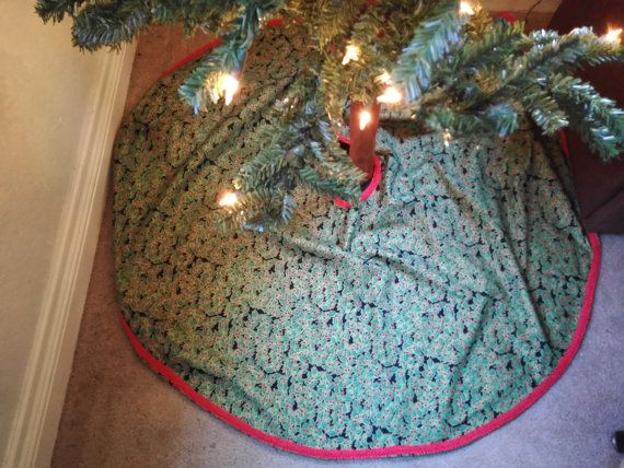 Holly berry tree skirt with red trim and black background Tree