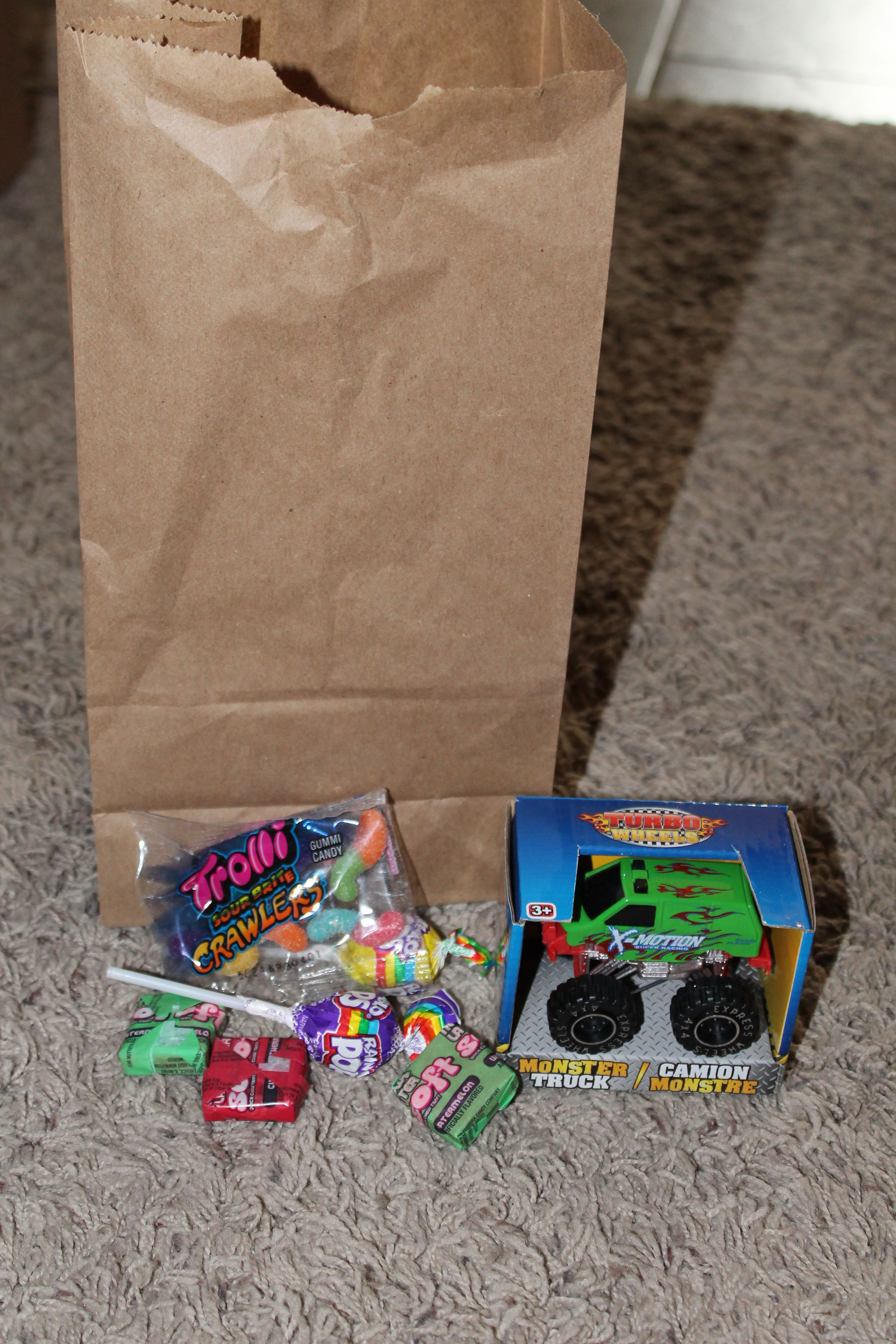 1 Monster Truck Toys From The Dollar Tree And Assorted Candy For