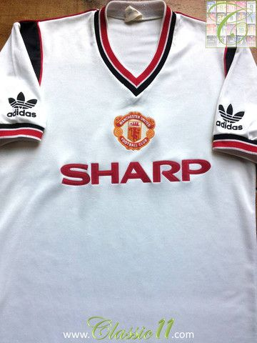 c253f976ee7 Relive Manchester United s 1984 1985 season with this vintage Umbro away football  shirt.