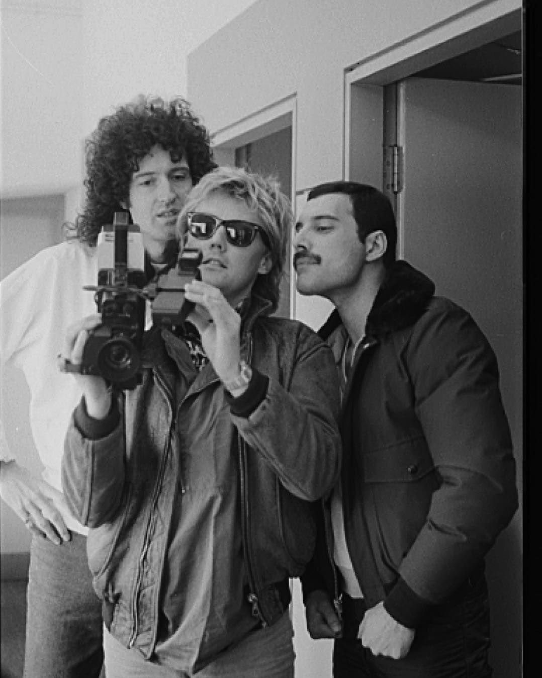 "simon fowler on Instagram: ""Brian May Roger Taylor Freddie Mercury Behind the Scenes at Radio Ga Ga. Roger showing his talents as a DoP to Brian and Freddie…"""