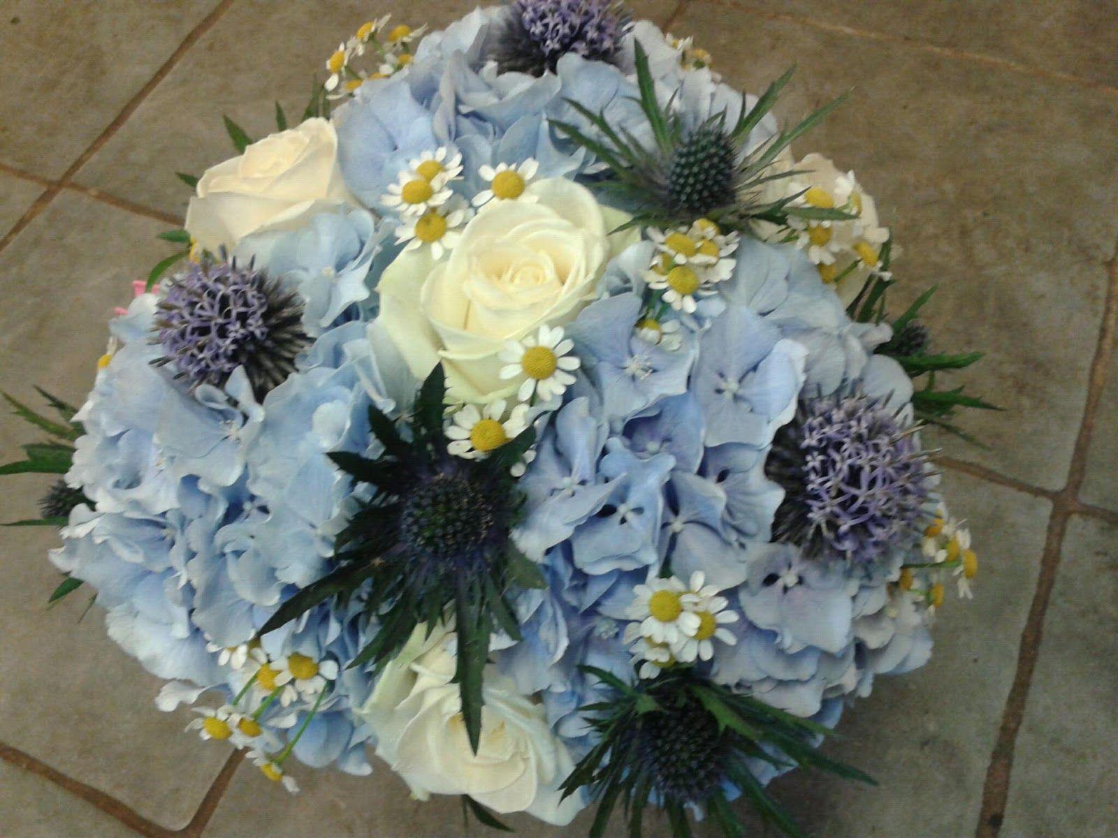 Blue Hydrangea, Blue Eryngium Thistle, Blue Glow Globes, Chamomile, White Roses Wedding Bouquet