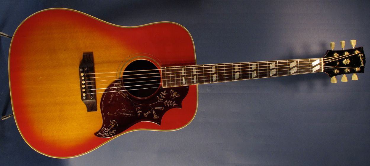 1968 Gibson Hummingbird Acoustic Guitar With Its Typical Cherry Sunburst Finish