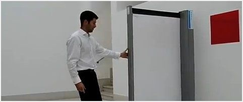 Retractable room divider takes up no floor space and doubles as a