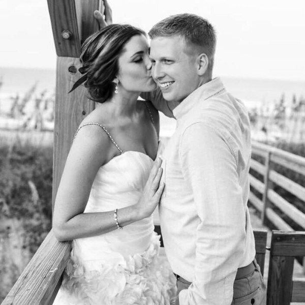 Check out the dress and jewelry this bride wore on her coastal inspired wedding day!  You can find similar items that are affordable.  Navy and blush with gold accents. #wedding #bridal #weddingday #weddingdress #weddingaccessories #weddinginvitations   East Coast Perspective