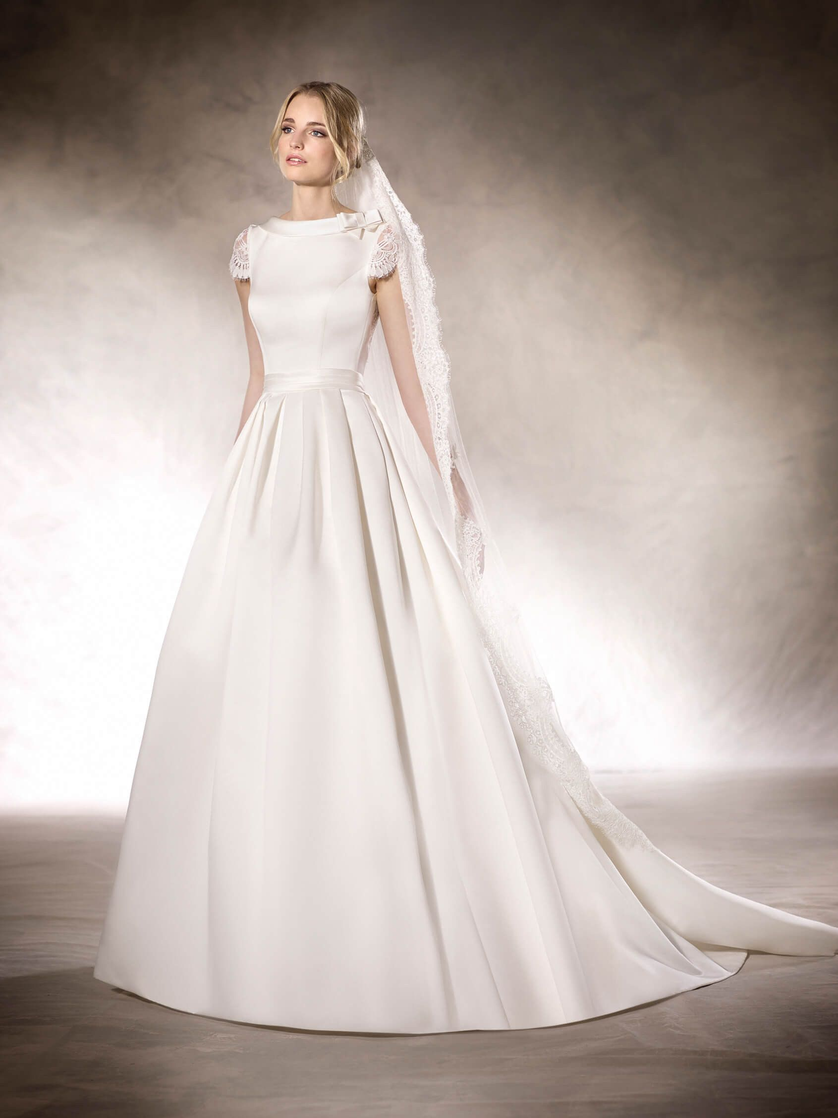HATIE is an unforgettable princess wedding dress with a bateau ...