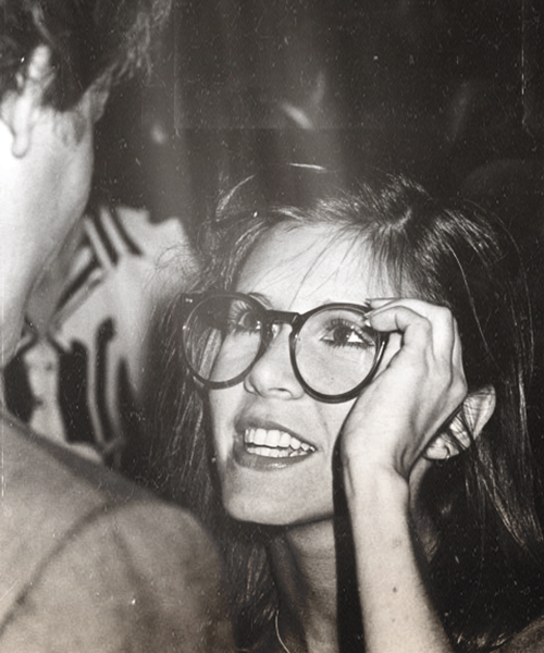 Carrie trying on Harrison's glasses...